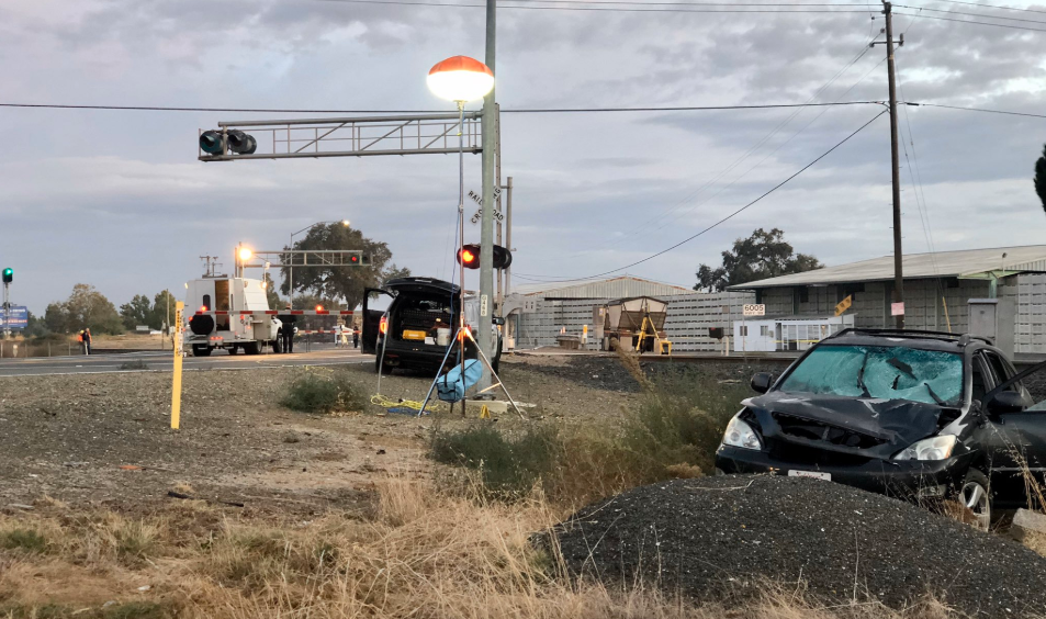 The scene after a California Highway Patrol officer was hit by a car near railroad crossing gates north of Live Oak on Oct. 19, 2019. (Credit: CHP)