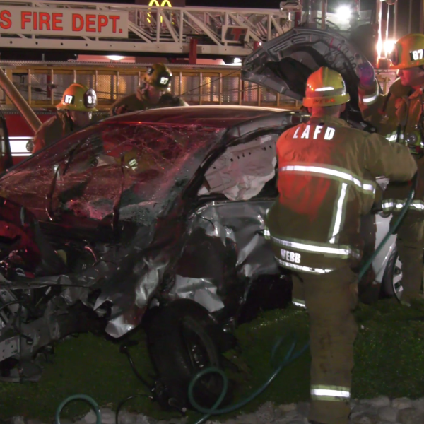 First responders from LAFD surround the badly-damaged vehicle of a driver who died in a crash with a pickup truck in Northridge on Oct. 20, 2019. (Onscene.TV)