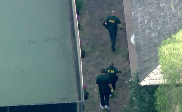 Authorities respond to actor Ron Ely's home in Hope Ranch, California, after the shooting on Oct. 15, 2019. (Credit: KTLA)