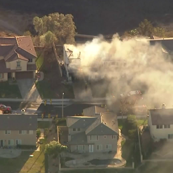 Smoke from a burning home lingers in the Santa Clarita Valley during the second day of the Tick Fire on Oct. 25, 2019. (Credit: KTLA)