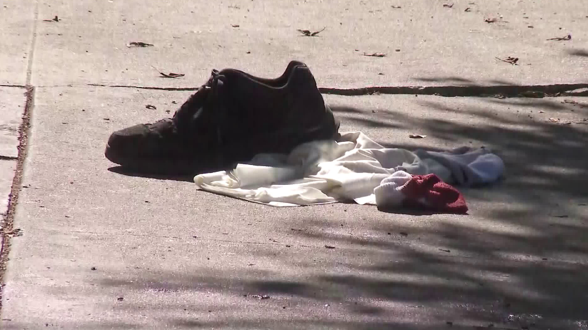 Discarded clothing lies on the sidewalk after a stabbing in the South Park area of South Los Angeles on Oct. 23, 2019. (Credit: KTLA)