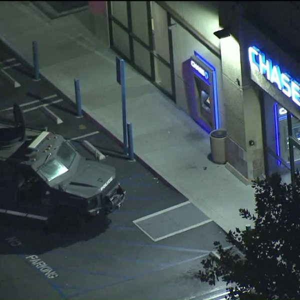 A police vehicle is seen at a Chase Bank in Colton on Oct. 1, 2019. (Credit: KTLA)
