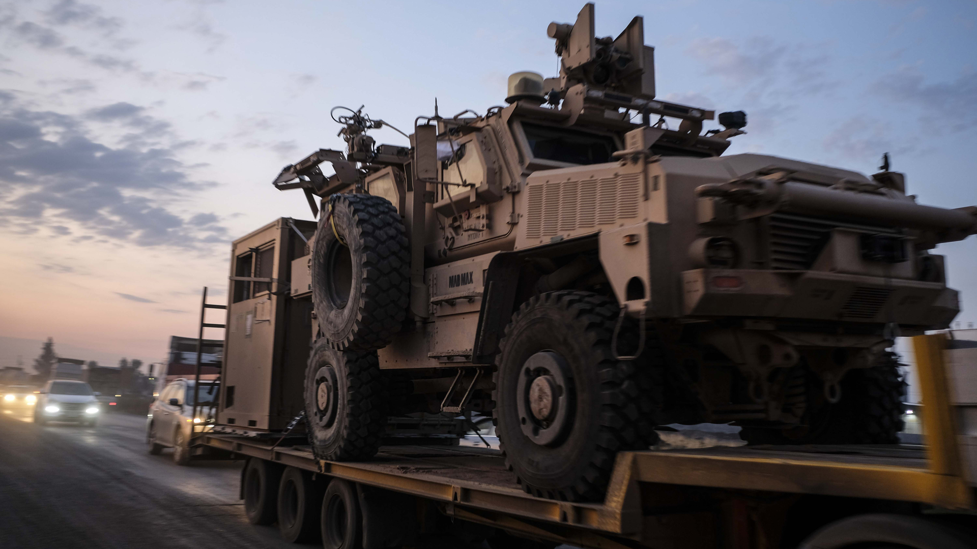 A convoy of U.S. armored military vehicles leave Syria on a road to Iraq on October 19, 2019 in Sheikhan, Iraq. (Credit: Byron Smith/Getty Images)