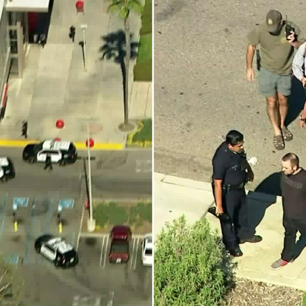 Police take a criminal threats suspect into custody after a pursuit ended outside a Target in Northridge, prompting a large law enforcement response on Oct. 23, 2019. (Credit: KTLA)