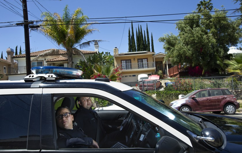 LAPD Officers Denise Vasquez and Oscar Bocanegra patrol in an area in Tarzana where a computer program predicted a higher possibility of property crimes in this undated photo. (Credit: Mel Melcon/ Los Angeles Times)