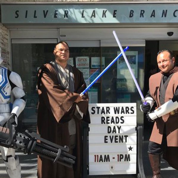 Performers dressed as Jedi knights and a Stormtrooper from Star Wars pose for a photo during an event at the Los Angeles Public Library's Silver Lake Branch Library on Oct. 12, 2019. (Credit: Los Angeles Public Library)