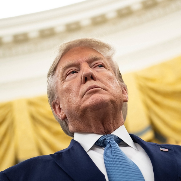 US President Donald Trump listens during a Presidential Medal of Freedom ceremony for Edwin Meese in the Oval Office at the White House in Washington, DC on October 8, 2019. (Credit: BRENDAN SMIALOWSKI/AFP via Getty Images)