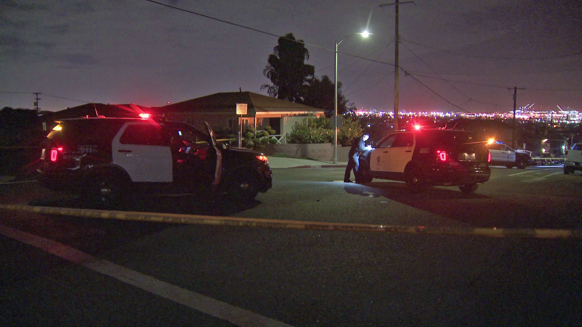Police investigate a shooting that left a man dead and two women wounded in San Pedro on Nov. 26, 2019. (Credit: KTLA)