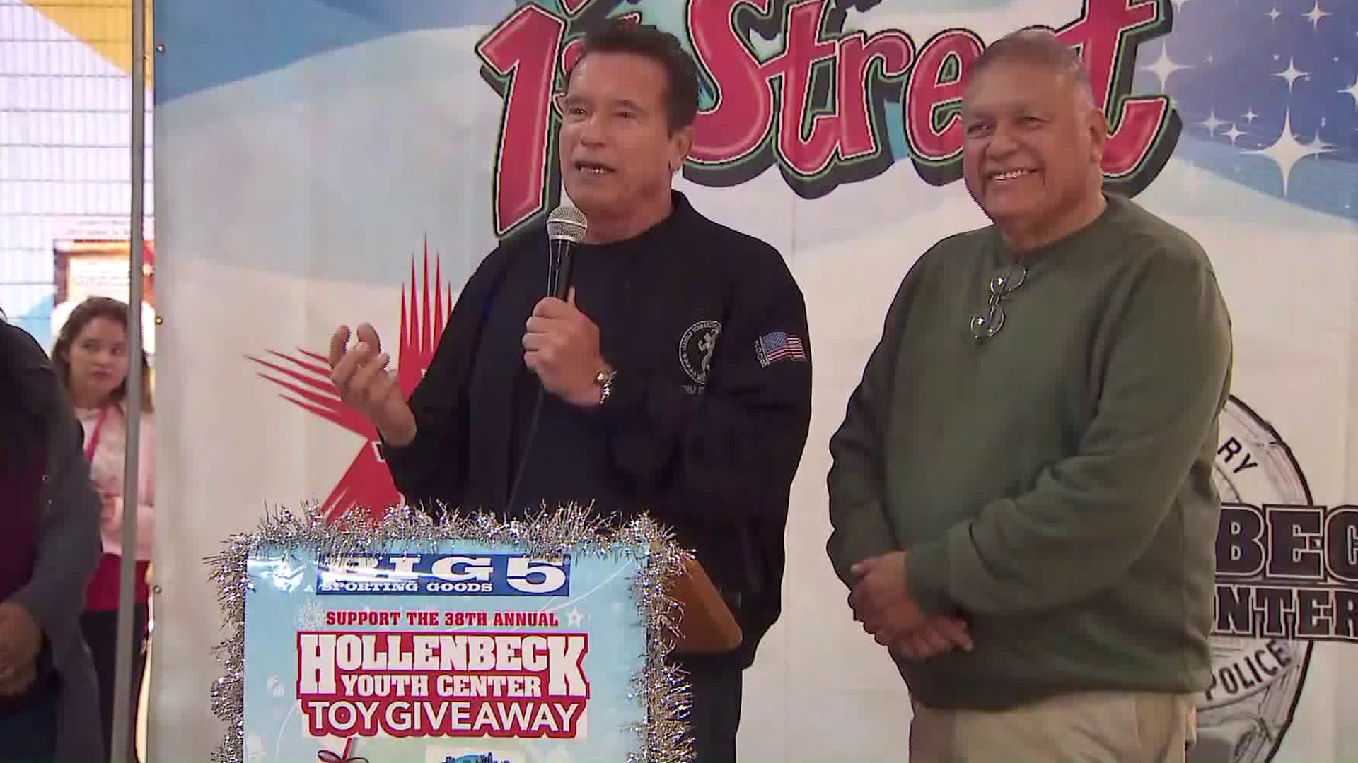 Former Gov. Arnold Schwarzenegger helps give away turkeys and food baskets to Boyle Heights residents as part of the Miracle on First Street holiday program on Nov. 25, 2019. (Credit: KTLA)