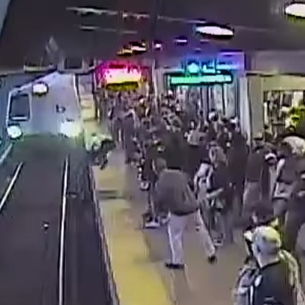 A still image of surveillance video showing an employee rescuing a man from BART tracks in Oakland on Nov. 3, 2019. (Credit: BART)