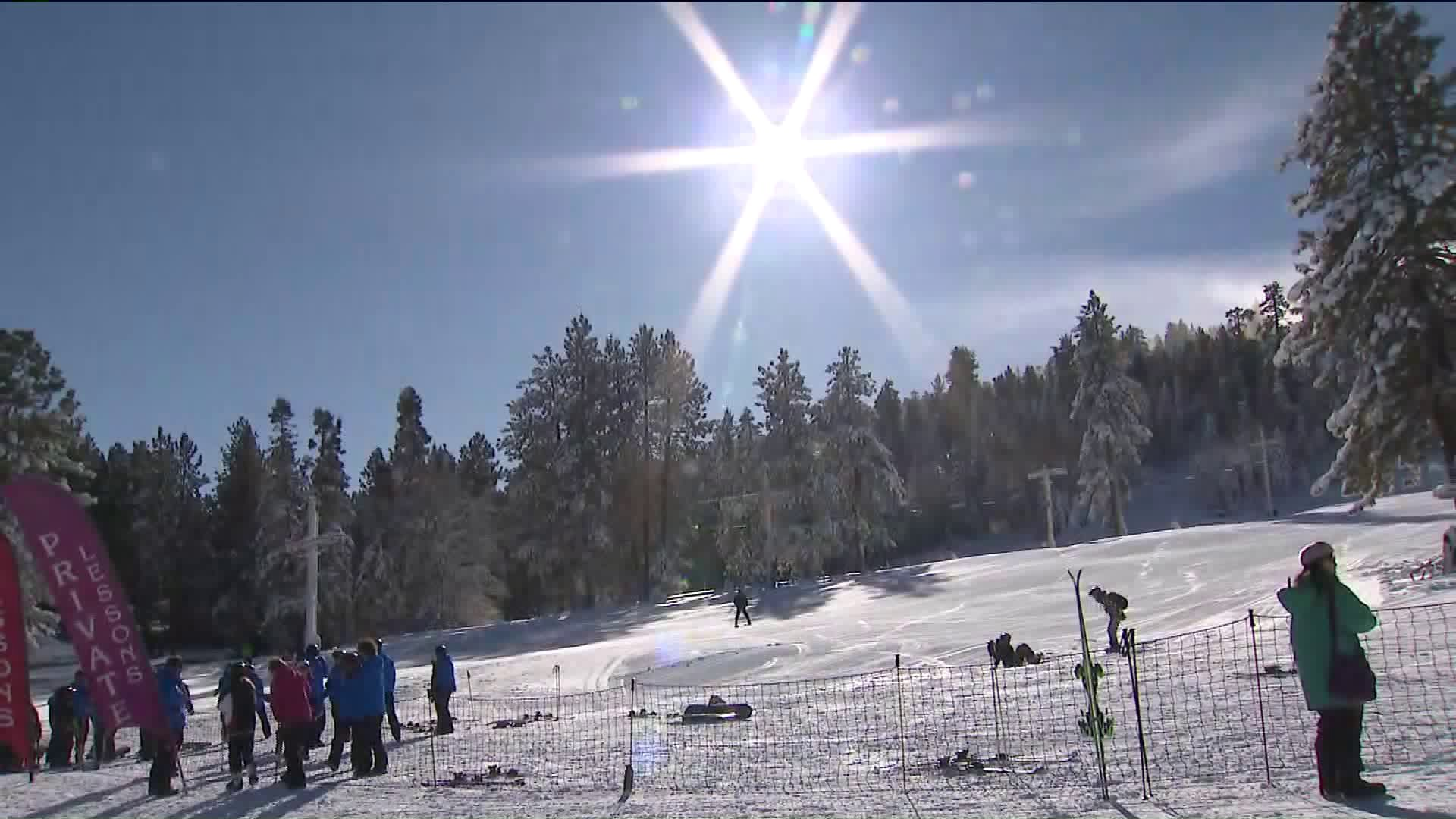 Skiers glide across the snow at Big Bear Mountain Resort on Nov. 30, 2019. (Credit: KTLA)