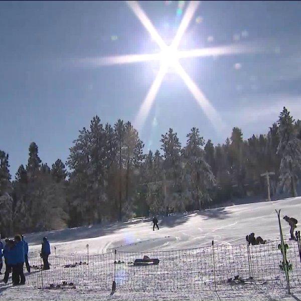 Skiers glide across the snow at Big Bear Mountain Resort on Nov. 30, 2019. (Credit: KTLA)