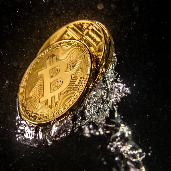 In this photo illustration a visual representation of the digital currency Bitcoin sinks into water on August 15, 2018 in London, England. (Credit: Dan Kitwood/Getty Images)