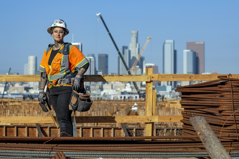 Rosa Garcia, a carpenter, is one of the many female construction workers involved in the 6th Street Bridge project over the Los Angeles River. She worked in retail before getting into construction in 2016. (Credit: Irfan Khan / Los Angeles Times)