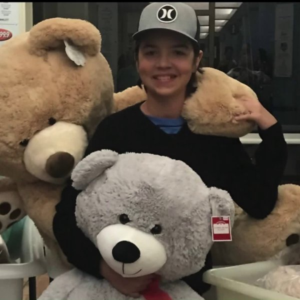 Caden Henderson, 14, of Redlands has collected teddy bears for hospitalized kids for the past three years. He's pictured on Nov. 27, 2019. (Credit: KTLA)