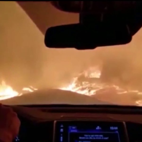 A vehicle makes its way through the flames of the Camp Fire. (File image)