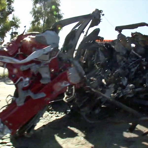 The wreckage of a car that crashed into a tree in Irvine, leave three people dead and fourth injured, is shown on Nov. 22, 2019. (Credit: KTLA)