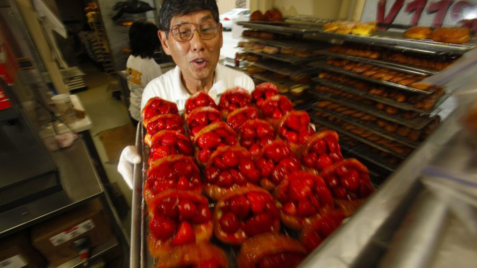 The Donut Man founder Jim Nakano with a tray of his strawberry donuts in 2011. The beloved shop will expand to downtown L.A.'s Grand Central Market next year.(Credit: Mark Boster / Los Angeles Times)