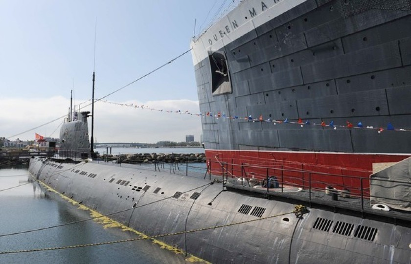The Russian Foxtrot-Class submarine known as the Scorpion sits next to the Queen Mary in this undated photo.(Credit: Wally Skalij / Los Angeles Times)