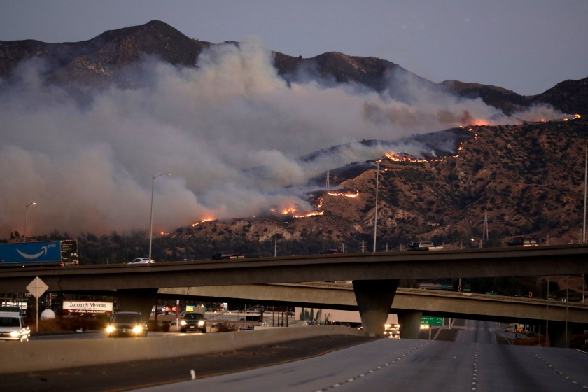 The Saddleridge Fire is seen after it broke out in Sylmar amid strong Santa Ana winds on Oct. 10, 2019. (Credit: Irfan Khan / Los Angeles Times)