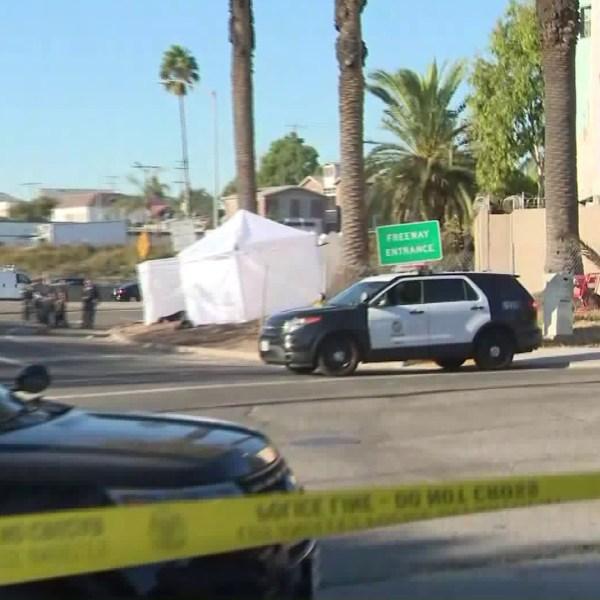 Los Angeles police assess the scene of a crash near the 101 Freeway in Echo Park on Nov. 1, 2019. (Credit: KTLA)