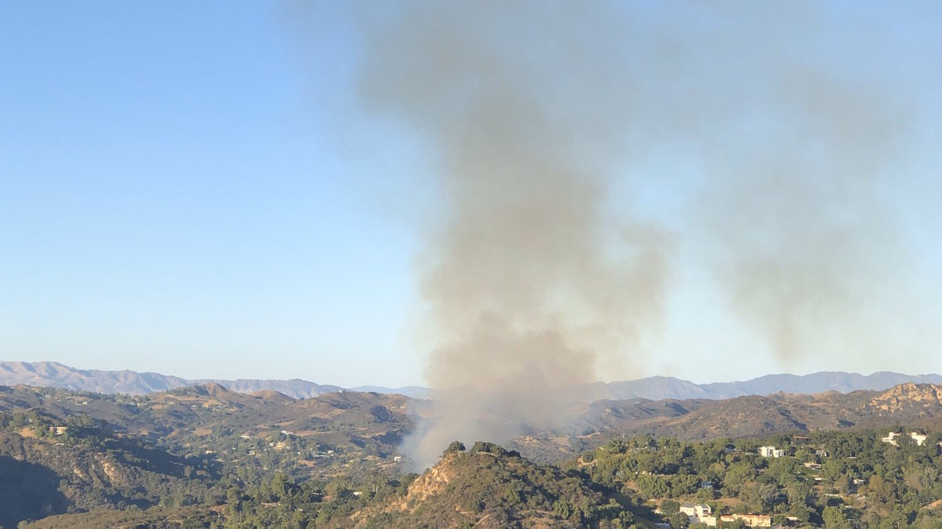 A brush fire ignited along Topanga Canyon Boulevard in Topanga on Nov. 16, 2019. (Credit: Los Angeles County Fire Department Air Operations Section)
