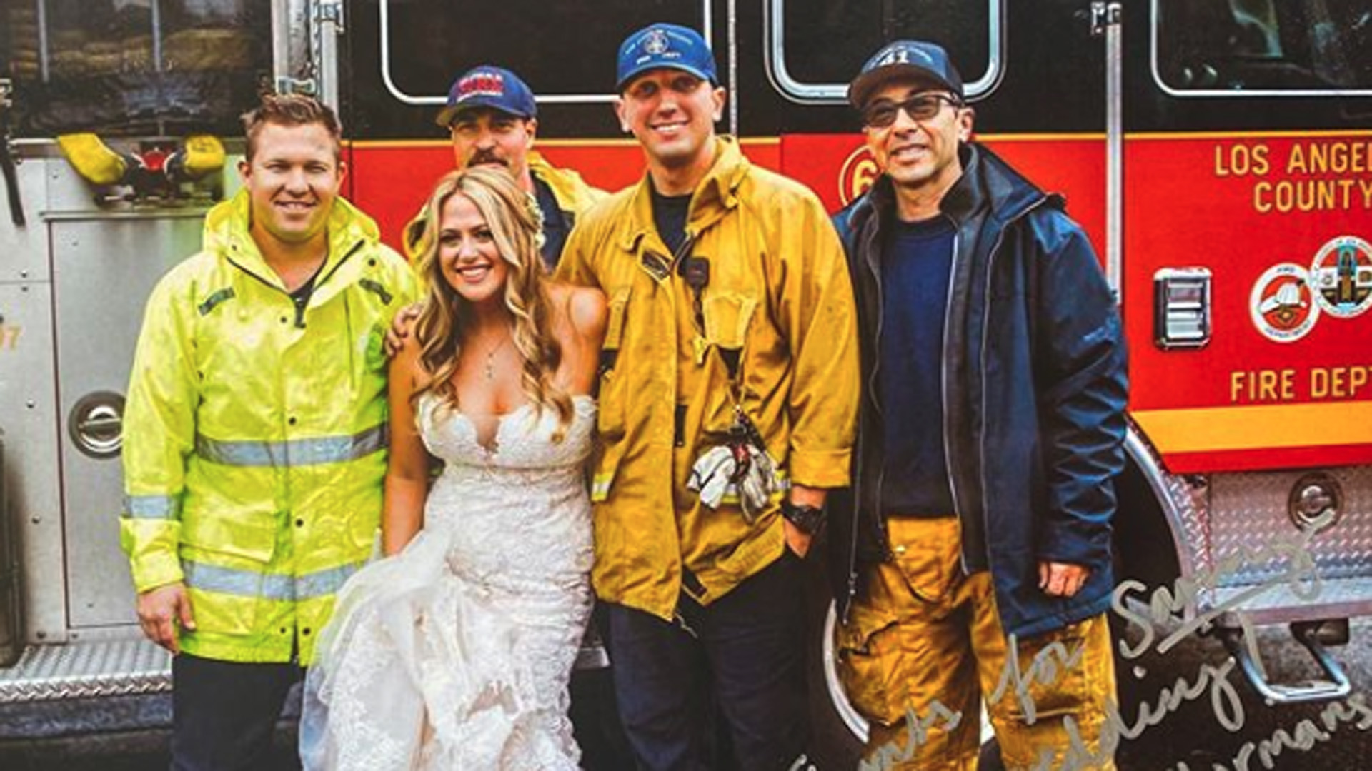 L.A. County firefighters and a bride they escorted to her wedding are seen in a photo posted by the department on Nov. 16, 2019.