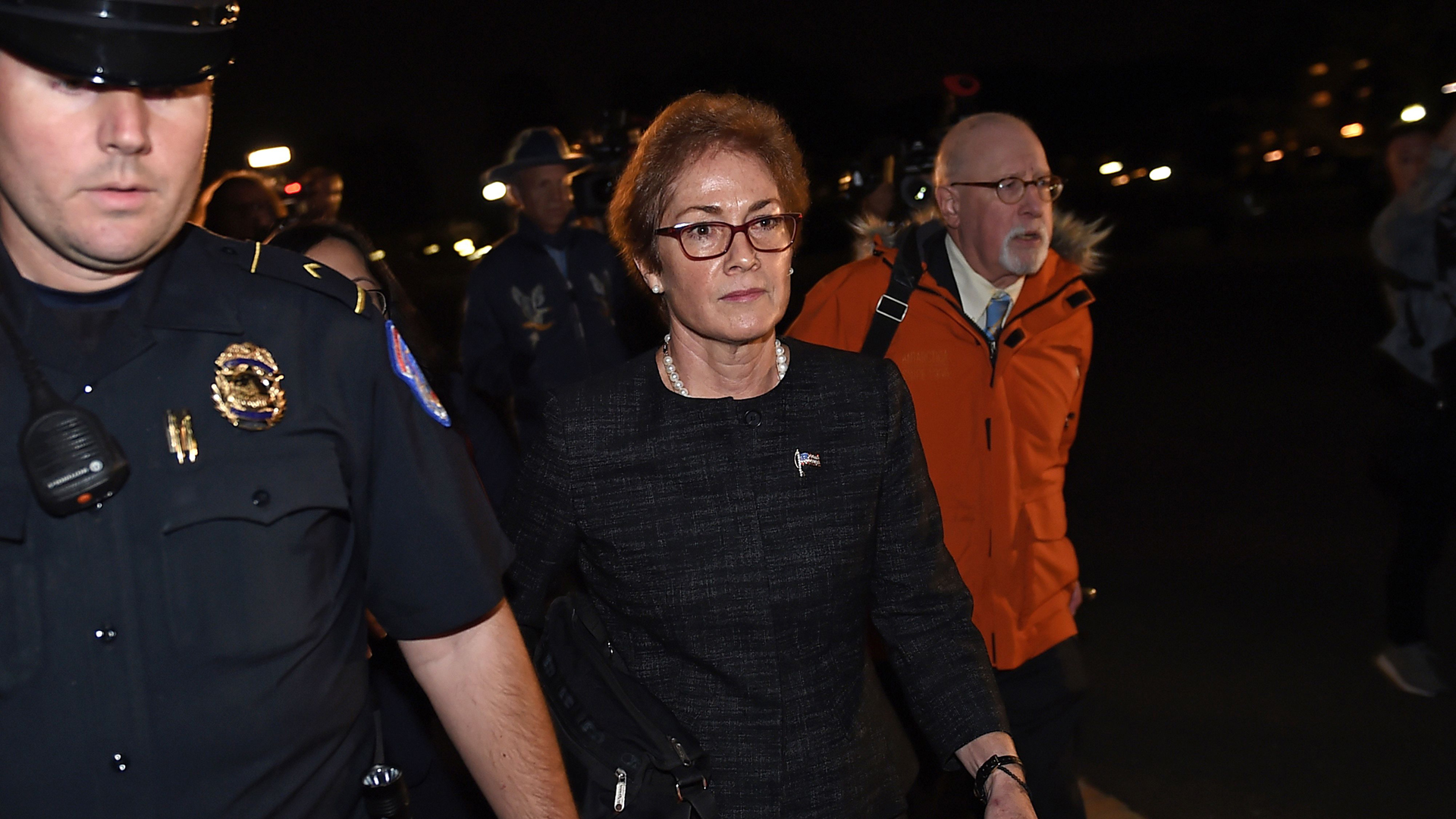 Former US Ambassador to Ukraine Marie Yovanovitch (C) flanked by lawyers, aides and Capitol police, leaves the US Capitol October 11, 2019 in Washington, DC after testifying behind closed doors to the House Intelligence, Foreign Affairs and Oversight committees as part of the ongoing impeachment investigation against President Donald Trump. (Credit: Olivier Douliery/AFP/Getty Images)