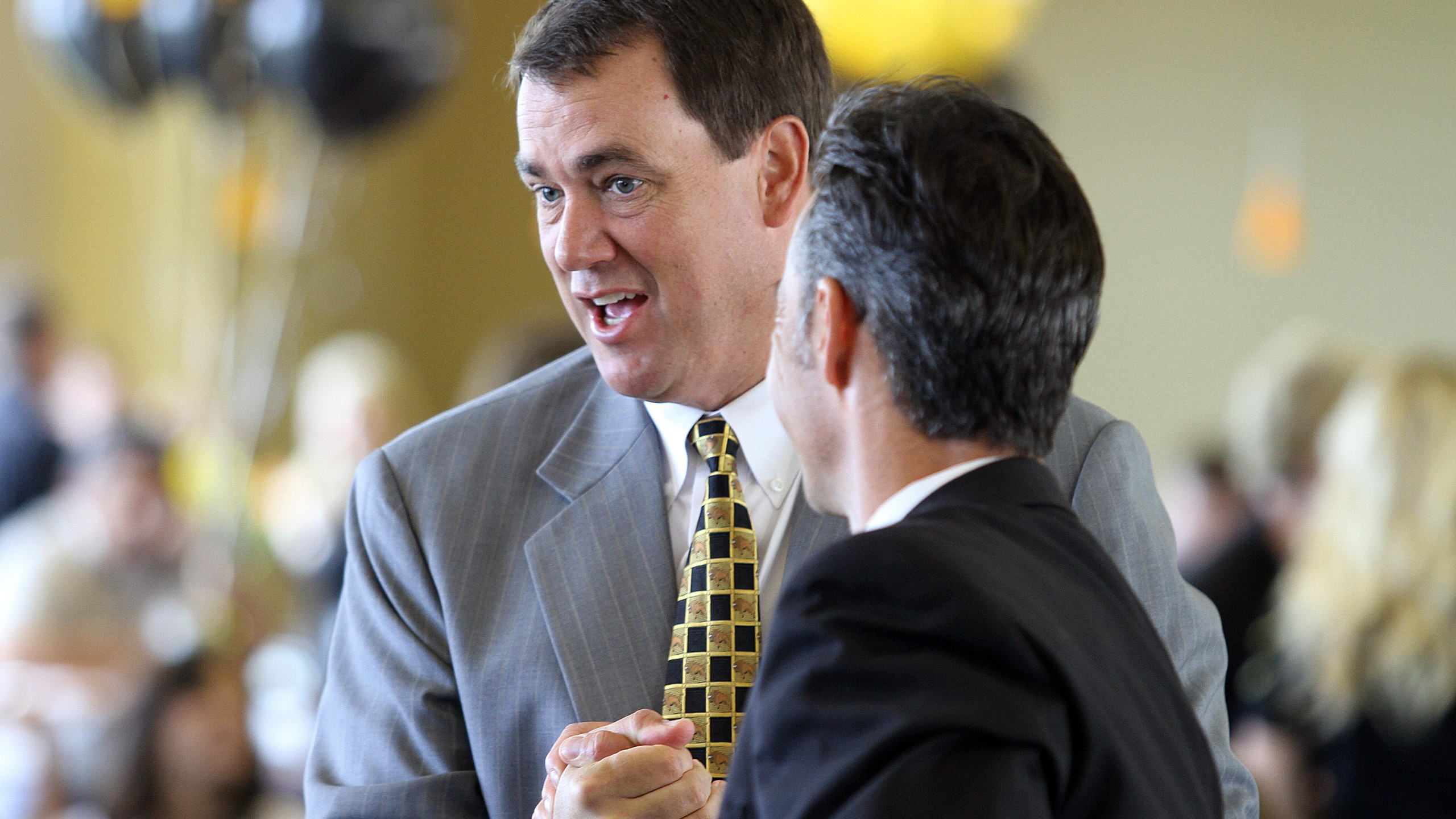 Mike Bohn, left, is seen at Folsom Stadium in Boulder while serving as the University of Colorado's athletic director on June 11, 2010. (Credit: Marc Piscotty/Getty Images)