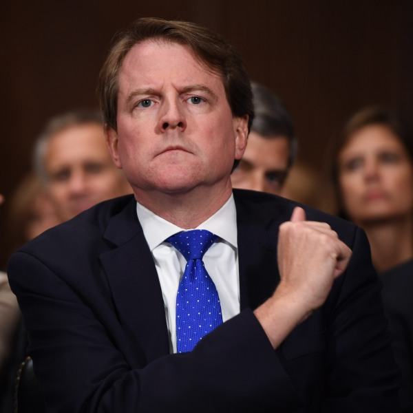 White House Counsel and Assistant to the President for U.S. President Donald Trump, Donald McGahn, listens to Supreme Court nominee Brett Kavanaugh as he testifies before the US Senate Judiciary Committee on Capitol Hill in Washington, DC, September 27, 2018. (Credit: SAUL LOEB/AFP via Getty Images)
