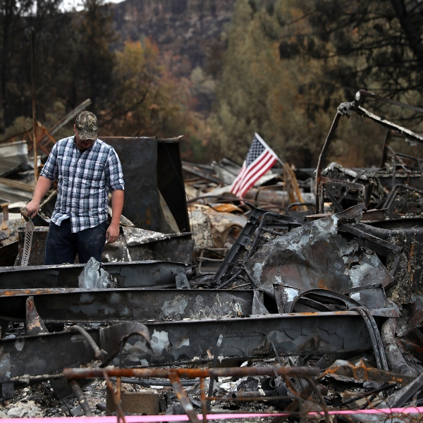 A man looks over his home that was destroyed by the Camp Fire on Nov. 22, 2018 in Paradise, California. (Credit: Justin Sullivan/Getty Images)