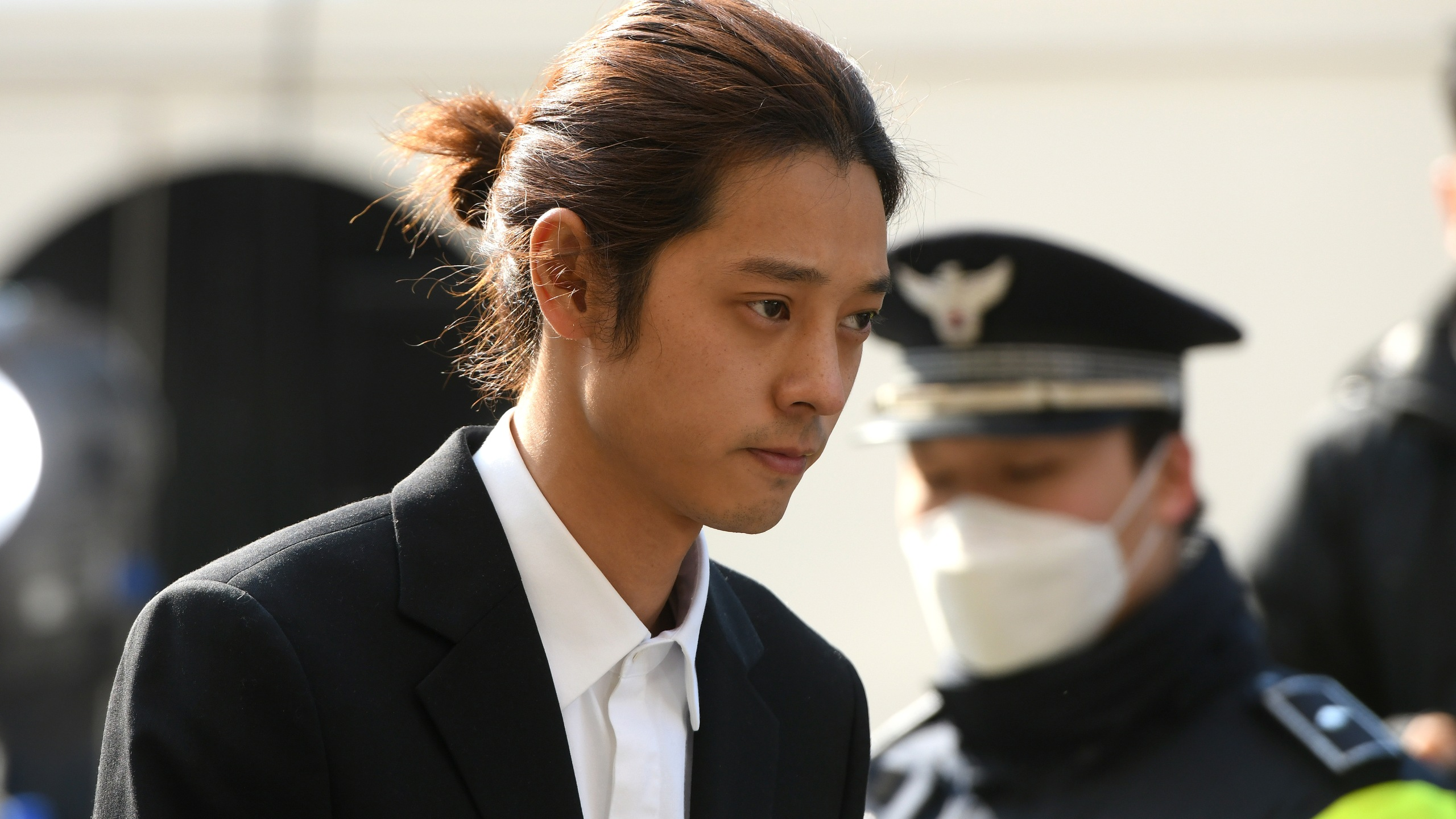 K-pop star Jung Joon-young arrives for questioning at the Seoul Metropolitan Police Agency in Seoul, South Korea on March 14, 2019. (Credit: JUNG YEON-JE/AFP via Getty Images)