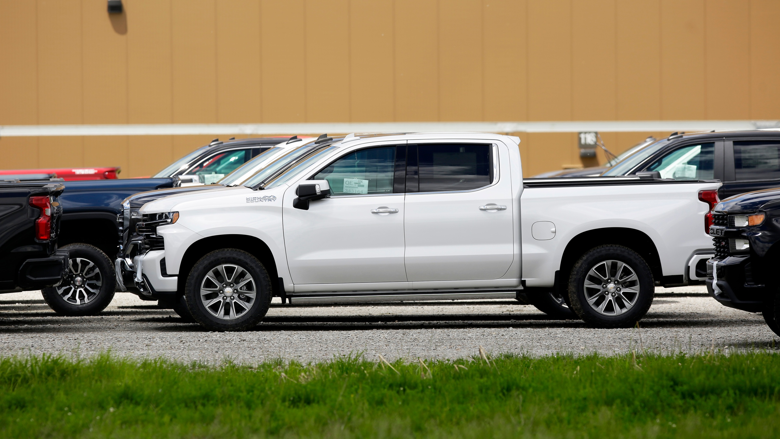 Chevrolet pickup trucks sit in a parking lot outside the GM Fort Wayne Assembly Plant on May 30, 2019 in Roanoke, Indiana. (Credit: Joshua Lott/Getty Images)