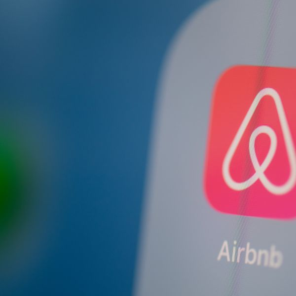 This illustration picture taken on July 24, 2019, in Paris, shows the logo of the U.S. online booking platform Airbnb on the screen of a tablet. (Credit: MARTIN BUREAU/AFP via Getty Images)