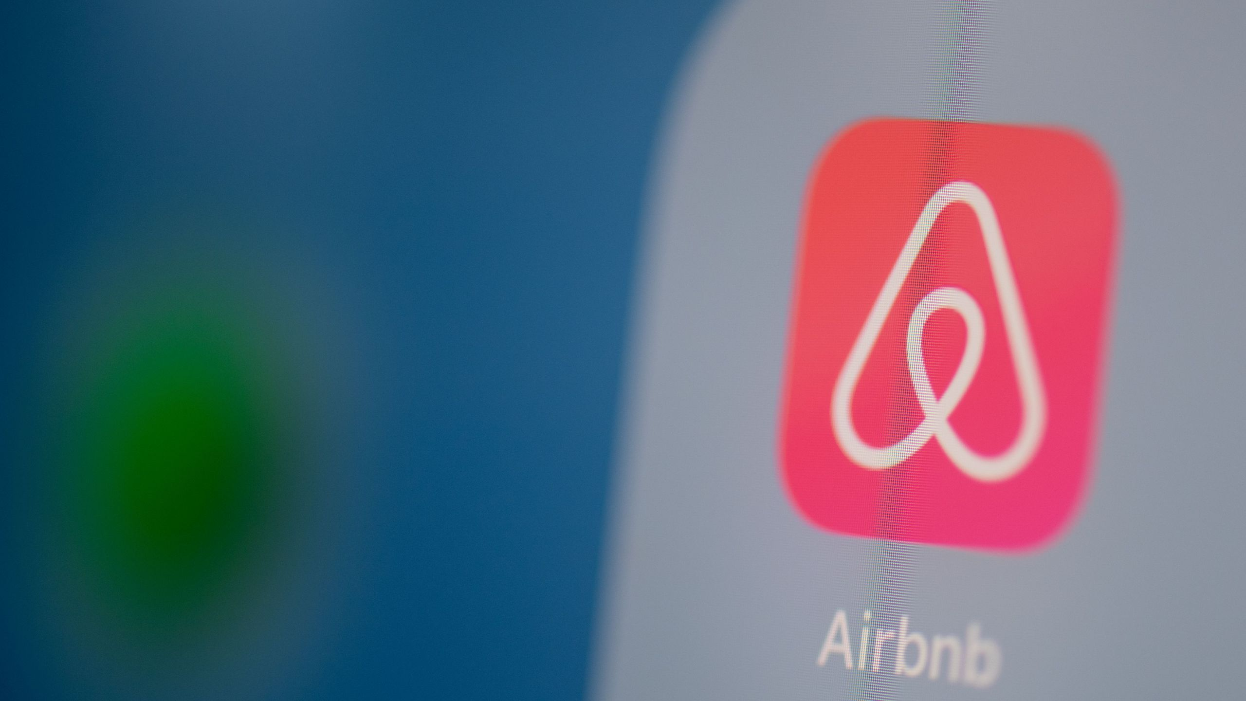 This illustration picture taken on July 24, 2019, in Paris shows the Airbnb logo on the screen of a tablet. (MARTIN BUREAU/AFP via Getty Images)