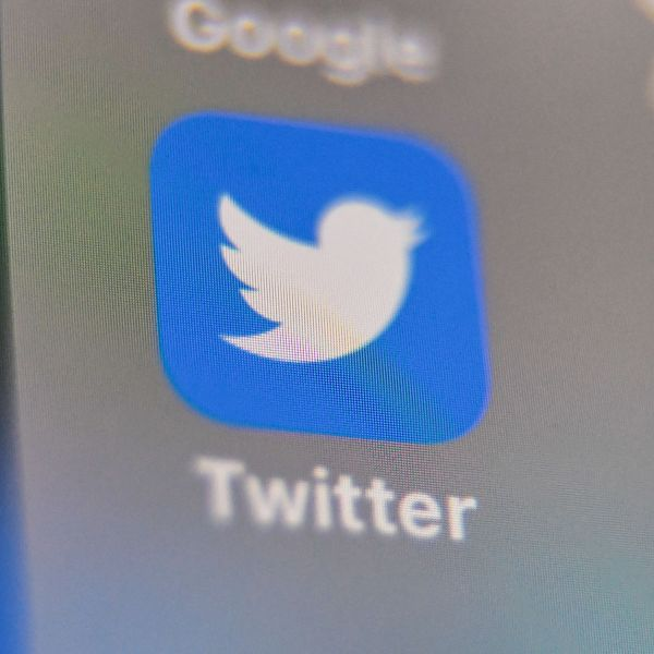 The Twitter app is seen on a phone in a file photo. (Credit: DENIS CHARLET/AFP via Getty Images)