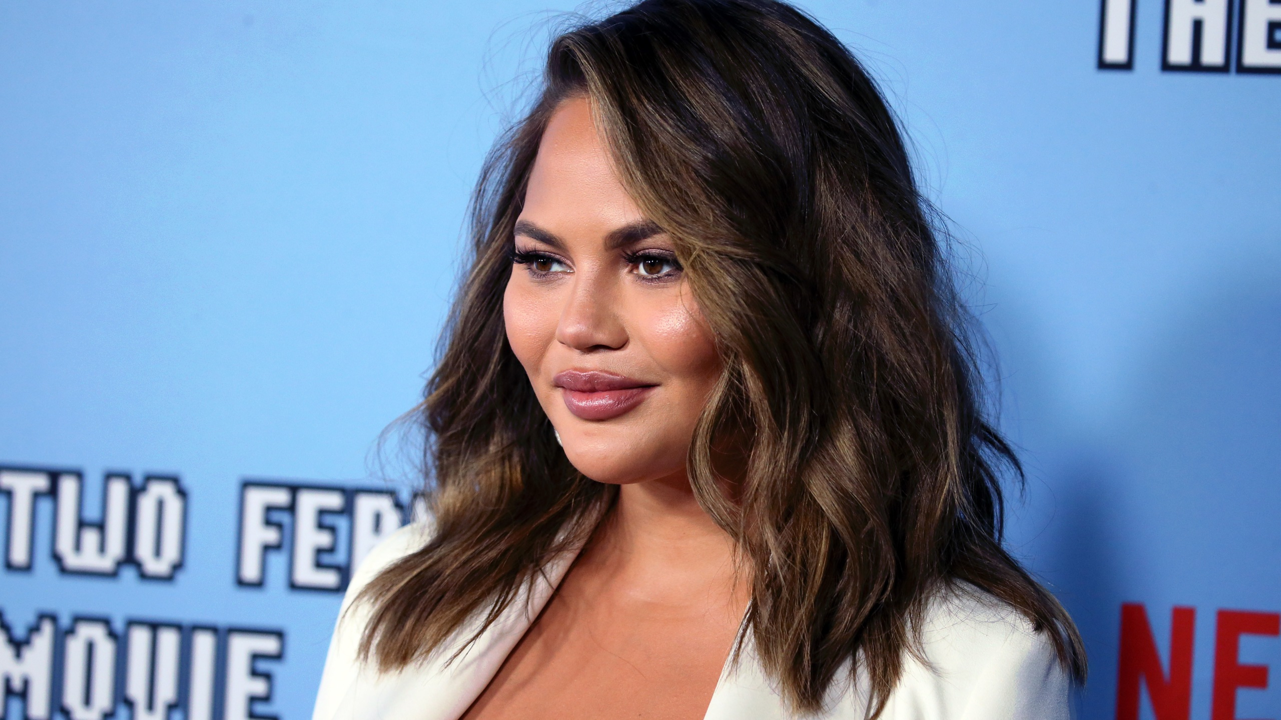 "Chrissy Teigen attends the LA premiere of Netflix's ""Between Two Ferns: The Movie"" at ArcLight Hollywood on September 16, 2019. (Credit: David Livingston/Getty Images)"