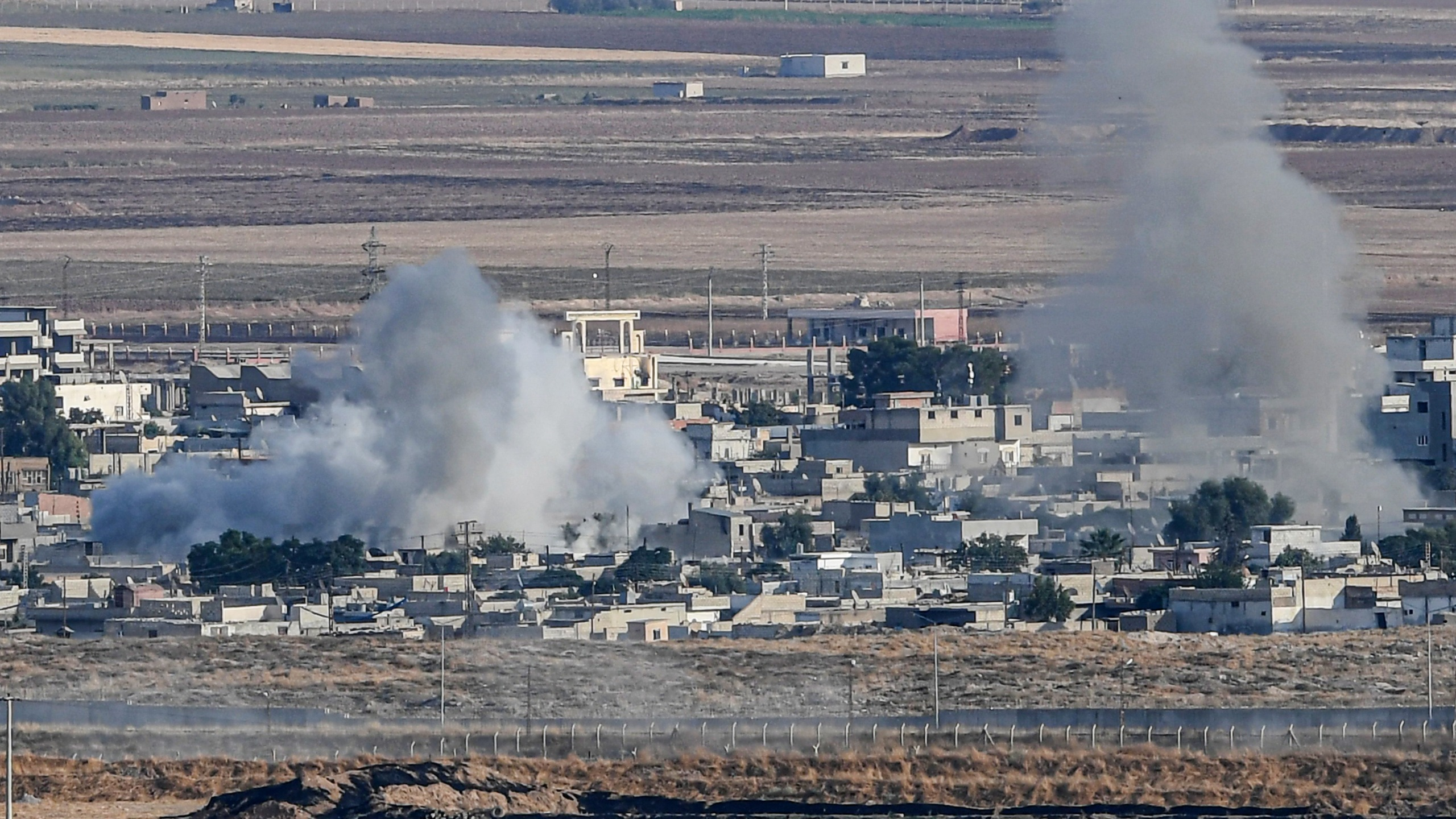 This picture taken on Oct. 15, 2019, from the Turkish side of the border at Ceylanpinar district in Sanliurfa shows smoke rising from the Syrian town of Ras al-Ain on the first week of Turkey's military operation against Kurdish forces. (Credit: OZAN KOSE/AFP via Getty Images)