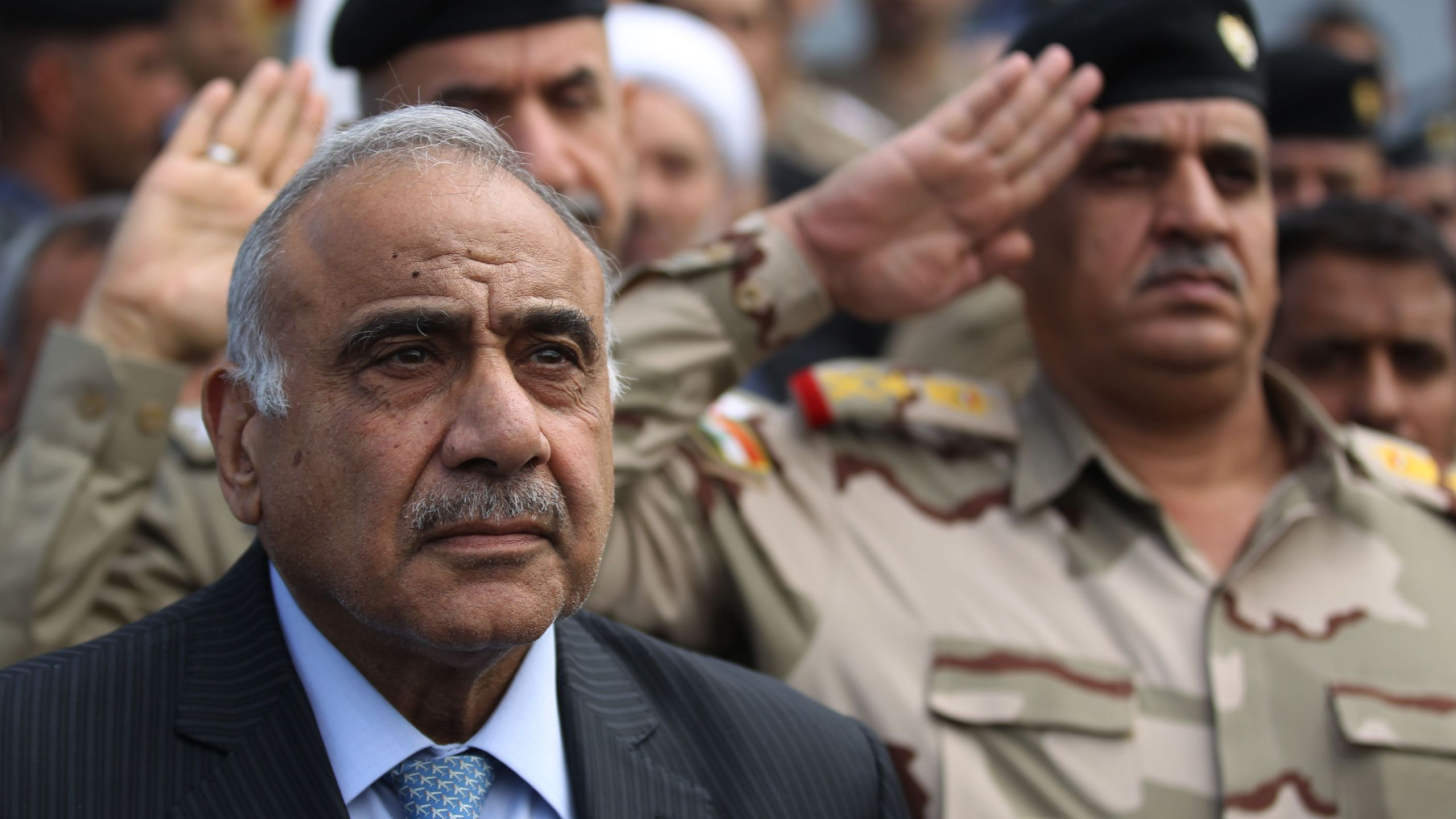 Iraq's Prime Minister Adel Abdel Mahdi speaks during a symbolic funeral ceremony in Baghdad on Oct. 23, 2019, for Major General Ali al-Lami, a commander of the Iraqi Federal Police's Fourth Division, who was killed the previous day in Samarra in the province of Salahuddin, north of the Iraqi capital. (Credit: AHMAD AL-RUBAYE/AFP via Getty Images)