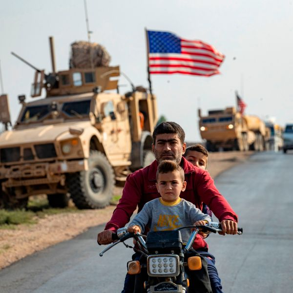 A convoy of U.S. military vehicles, arriving from northern Iraq, passes through the Syrian northeastern city of Qamishli on Oct. 26, 2019. (Credit: Delil Souleiman/AFP via Getty Images)