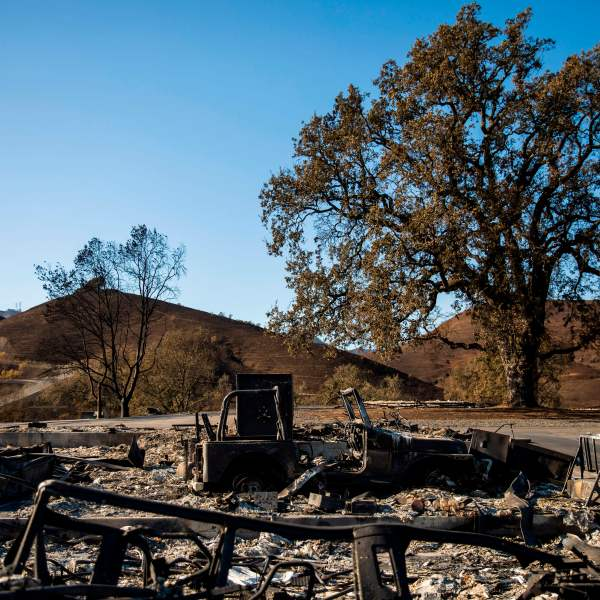 A burned vehicle sits on a property devastated by the Kincade Fire off Briggs Ranch Road in Kellogg on Oct. 31, 2019. (Credit: PHILIP PACHECO/AFP via Getty Images)