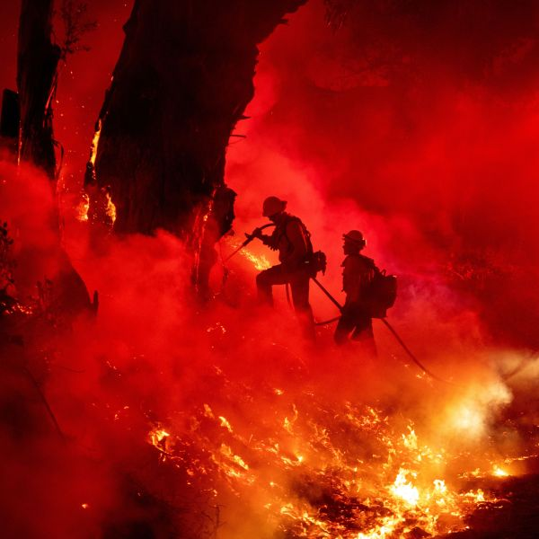 Firefighters work to control flames from a backfire during the Maria Fire near Santa Paula on Nov. 1, 2019. (Credit: Josh Edelson / AFP / Getty Images)