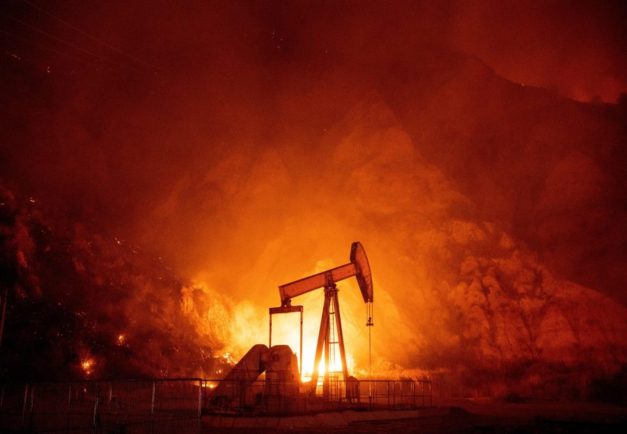 Flames from the Maria Fire burn through an oil field in Santa Paula on Oct. 31, 2019. (Credit: JOSH EDELSON/AFP via Getty Images)