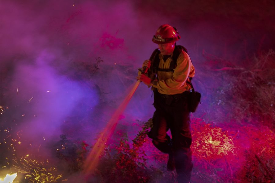 Firefighters control a backfire they set at the Maria Fire on Nov. 1, 2019. (Credit: David McNew/Getty Images)