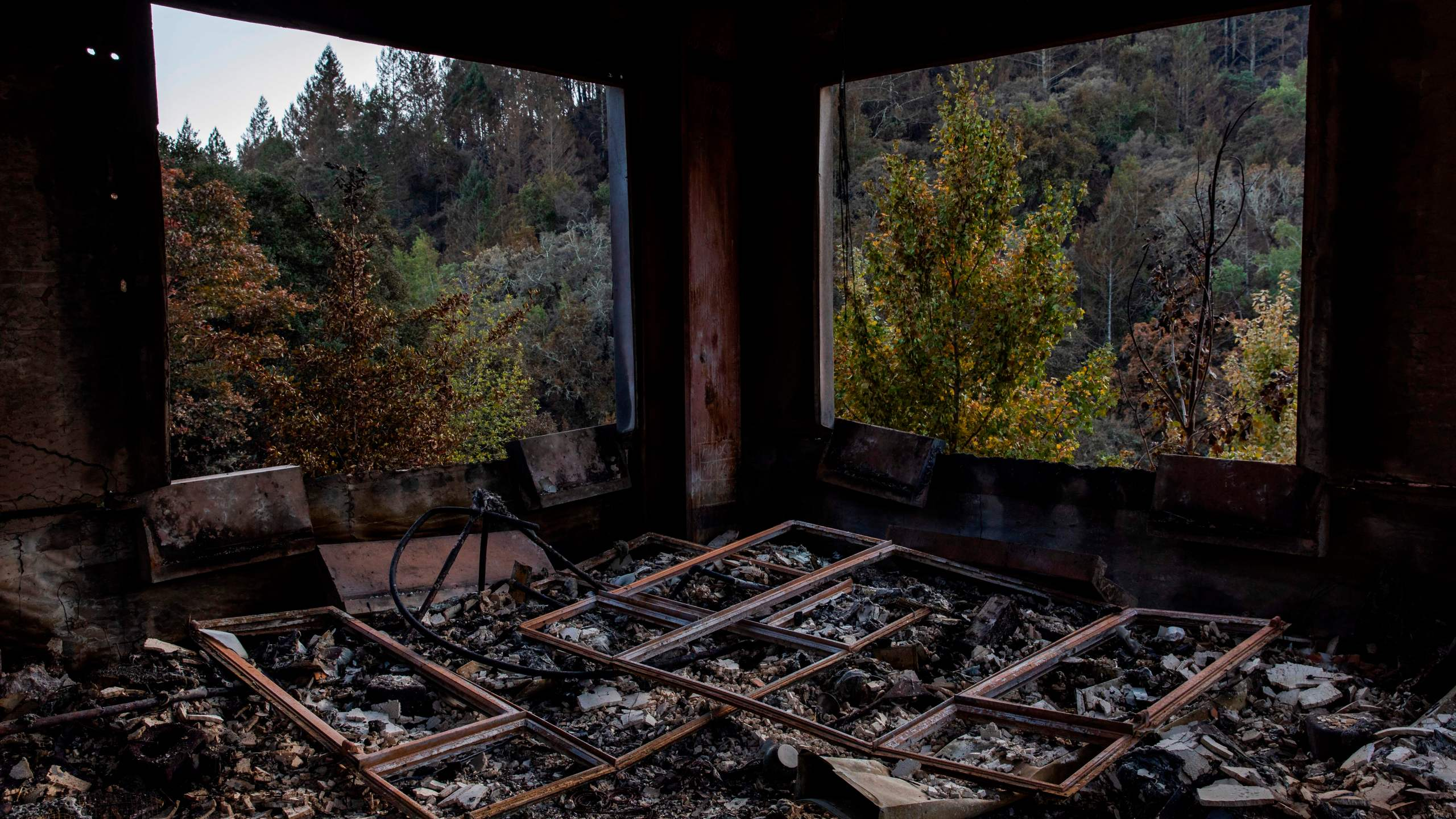 Window panes lay on the floor of a structure devastated by the Kincade Fire in Kellogg on Oct. 31, 2019. (Credit: Philip Pacheco / AFP / Getty Images)