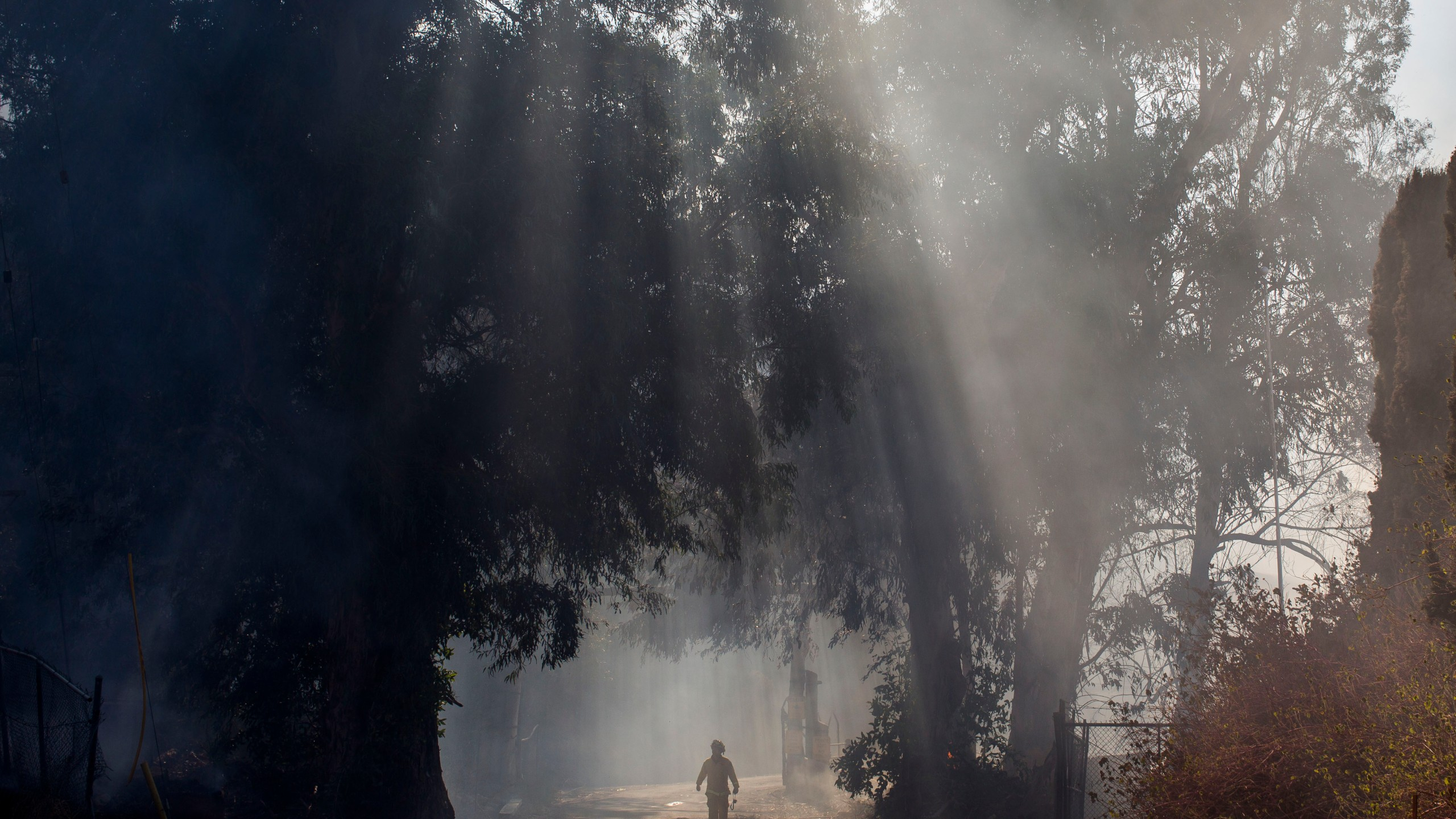 A firefighter walks into the smoke of the Maria Fire at South Mountain Road, in Santa Paula, Ventura County, in California, on Nov. 1, 2019. (Credit: APU GOMES via Getty Images)