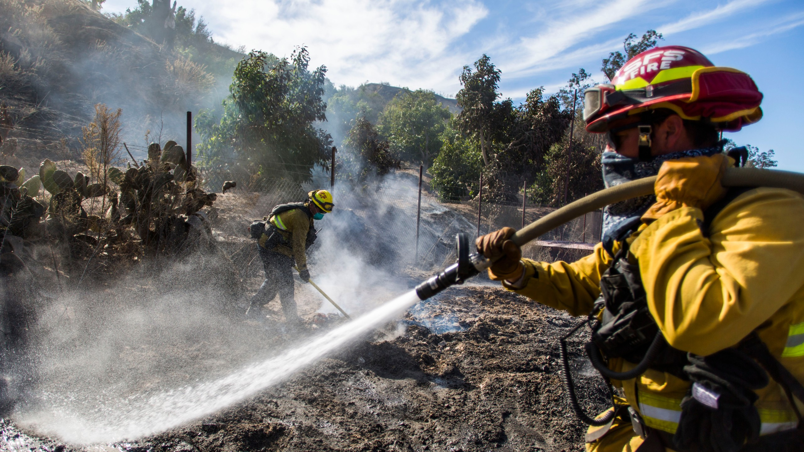 Firefighters from Santa Fe Springs battle to control hotspots during the Maria Fire in Santa Paula area on Nov. 2, 2019. (Credit: Apu Gomes / AFP / Getty Images)
