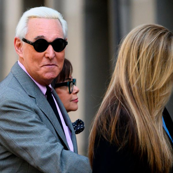 Roger Stone enters the E. Barrett Prettyman U.S. Court House with his wife Nydia, center, and daughter Adria Stone, right, on Nove. 5, 2019 in Washington, D.C. (Credit: ANDREW CABALLERO-REYNOLDS/AFP via Getty Images)