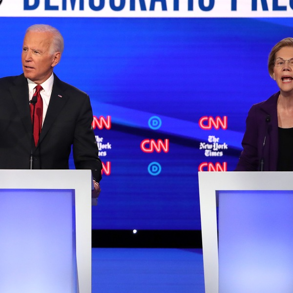 Former Vice President Joe Biden and Sen. Elizabeth Warren (D-MA) react during the Democratic Presidential Debate at Otterbein University on Oct. 15, 2019, in Westerville, Ohio. (Credit: Win McNamee/Getty Images)