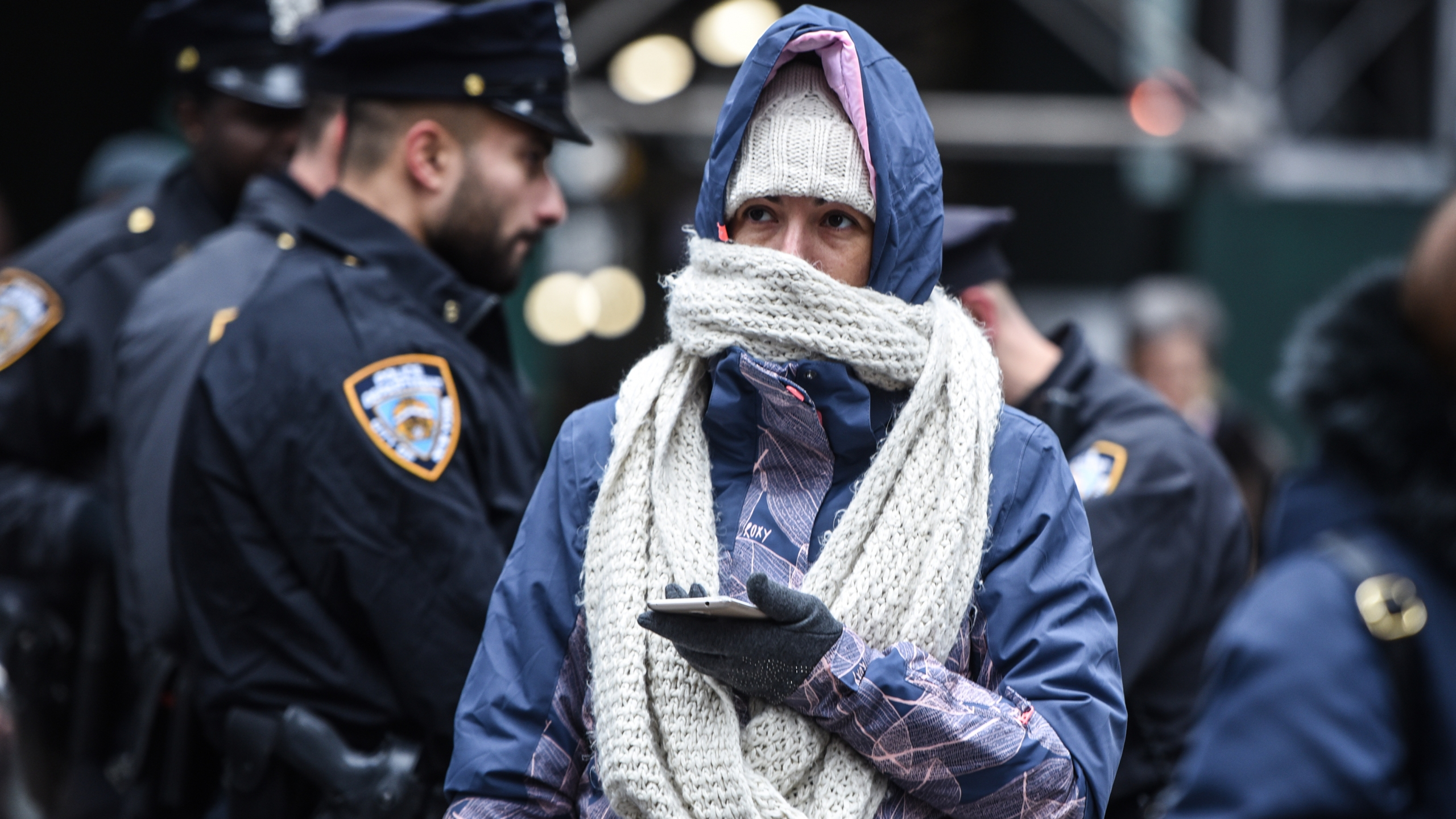 A person bundles up against the cold on November 12, 2019 in New York City. (Credit: Stephanie Keith/Getty Images)